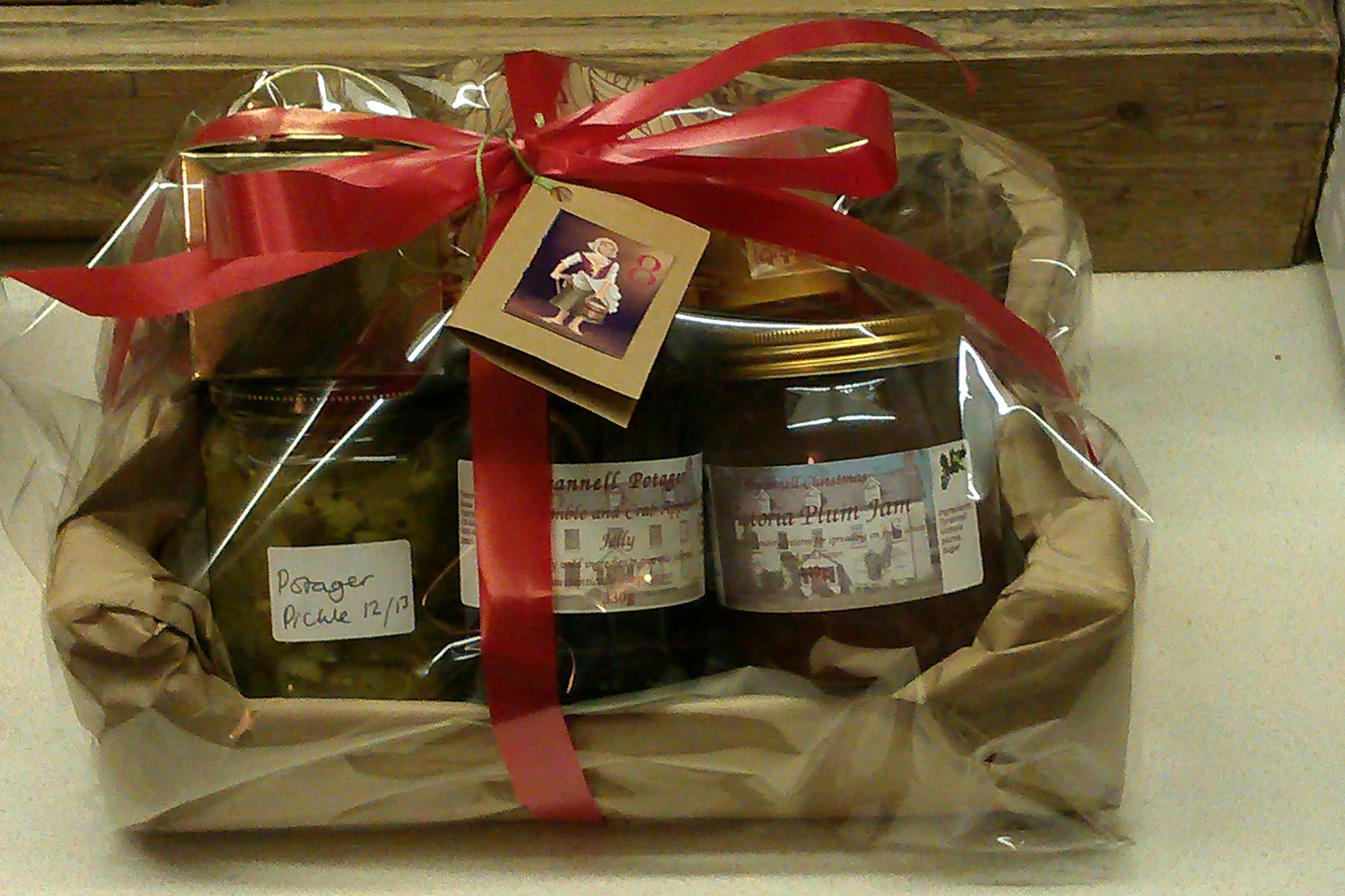 A hamper featuring some preserves of garden produce