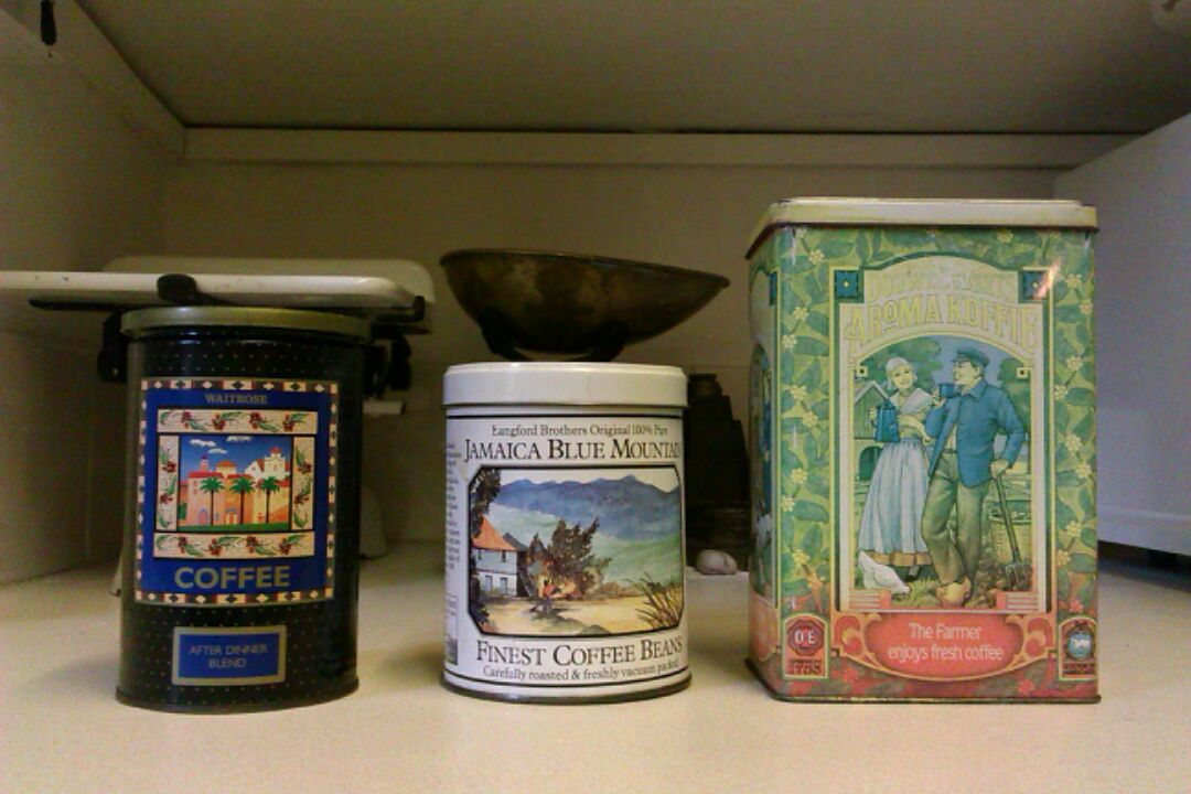 Our collection of coffee tins, including Blue Mountain, in the middle.